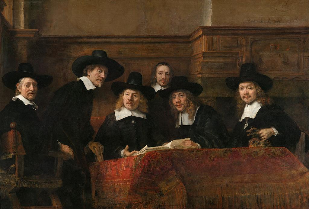 1024px-Rembrandt_-_De_Staalmeesters-_het_college_van_staalmeesters_(waardijns)_van_het_Amsterdamse_lakenbereidersgilde_-_Google_Art_Project